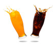 Couple soft drink splashing out of glass isolated on white background.