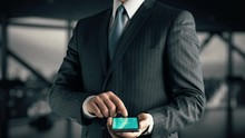 Businessman With Learn Estonian Hologram Concept