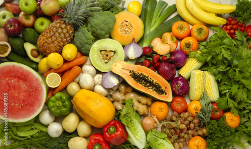 Photo Buffet of many fruits and vegetables in a collection of food nutrition with overhead view showing color and variety