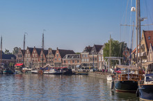Boats And Old Houses In The Harbor Of Hoorn