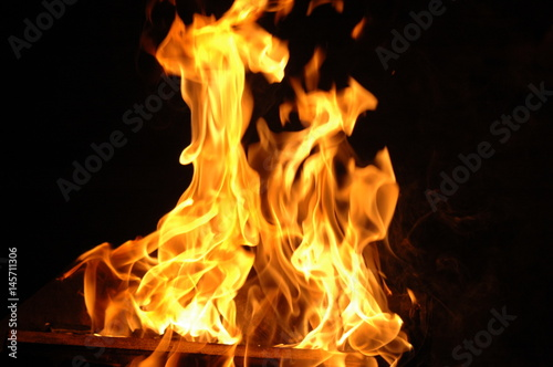 Photo Stands Fire / Flame fire campfire on a dark background