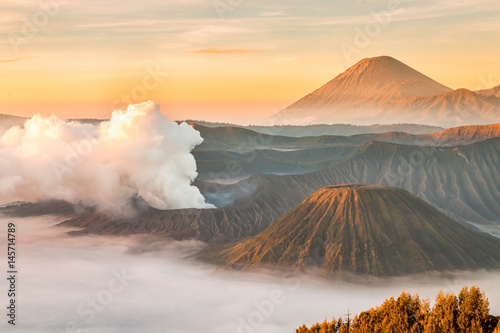 Landscape of Mount Bromo volcano, Batok and Semeru (Mt.) during sunrise from viewpoint on Mount Penanjakan located in Bromo Tengger Semeru National Park, East Java, Indonesia.