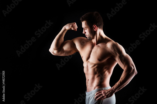 Billede på lærred Muscular and sexy torso of young man having perfect abs, bicep and chest