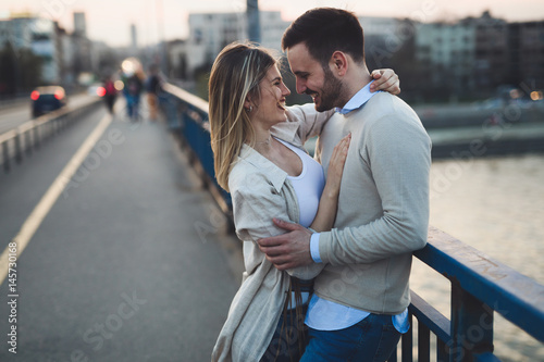 Fototapeta Happy romantic couple hugging and smiling obraz na płótnie