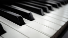 Piano Keyboard On Black Backgr...
