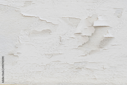 closeup surface of old white crack grunge concrete wall - use for background or backdrop in building structure detail concept. Construction.