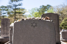 Headstone In Jewish Cemetery With Star Of David And Memory Stones