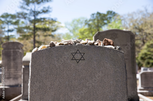 Fotografie, Obraz  Headstone in Jewish Cemetery with Star of David and Memory Stones