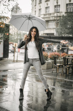 Woman Dancing In The Rain With...