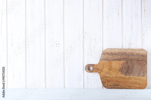 Brown cutting board on white wall paneling background - Buy