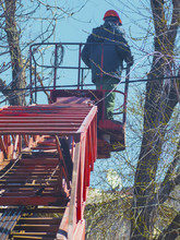 Worker On The Red Lift Machine