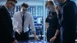 Team of Government Agents Tracking Fugitive with Help of Touchscreen Interactive Table in Big Monitoring Room Full of Computers with Animated Screens.Shot on RED EPIC-W 8K Helium Cinema Camera.