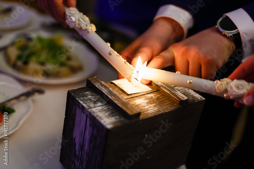 Photo  Two advent lights burning Two burning candles Wooden box