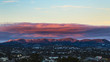 sunset over mountain range with slight dusting of snow
