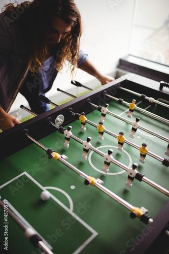 Man playing table football game