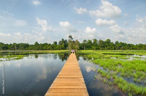 Fotobehang Bleke violet The wooden path towards to Neak Pean temple on artificial island. Angkor.