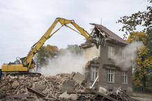 A Digger Demolishing Houses Fo...