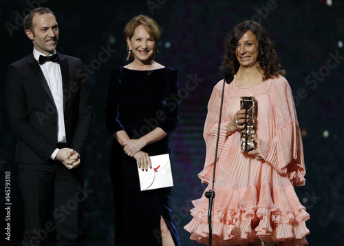 Director Houda Benyamina reacts as she receives the Best