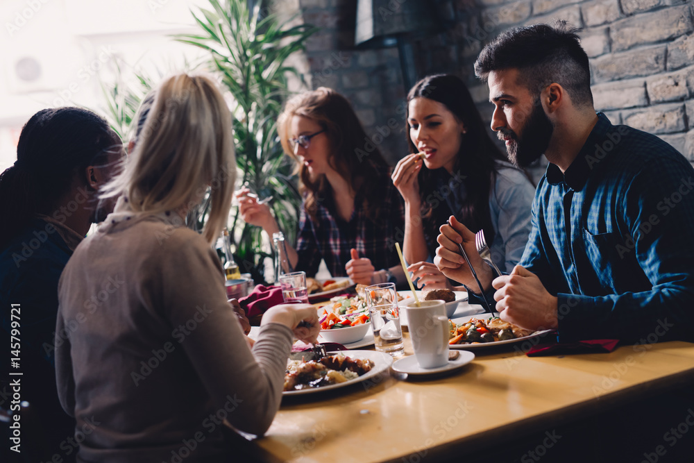 Fototapety, obrazy: Group of happy business people eating in restaurant