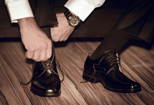 Groom Wearing Shoes On Wedding Day , Tying The Laces