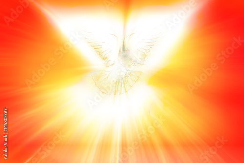 Valokuva  Holy Spirit, Pentecost or Confirmation symbol with a dove, and bursting rays of flames or fire