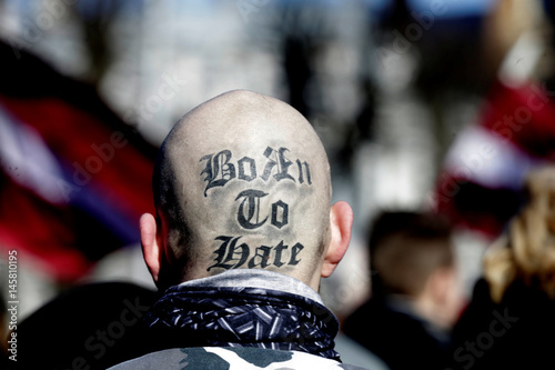A man with a tattoo on his head attends the annual