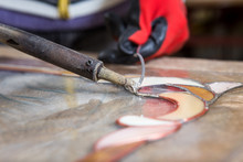 Stained Glass Maker Works With Souvenirs
