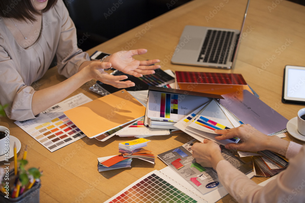 Fototapeta Two business women are doing product planning meeting