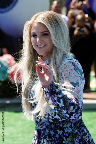 Actor and singer Meghan Trainor waves as she arrives at the
