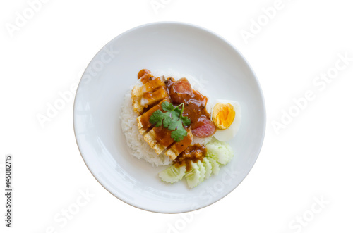 Photo  Rice crispy pork in sauce with rice isolated on white background