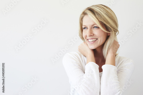Fototapeta  Laughing blond babe in white studio