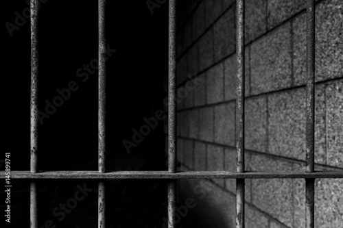 Photo  old prison bars cell lock background dark black and light