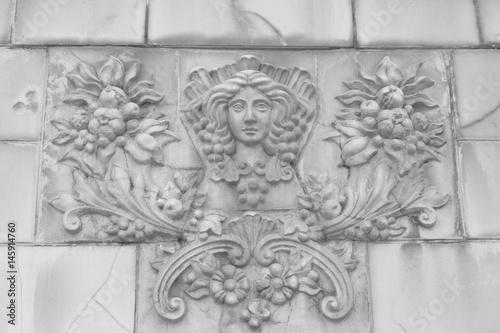 Fotografija  Goddess of fertility bas-relief on a fence