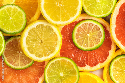 Photo Stands Slices of fruit Grapefruit, lime, lemon, and orange slices background