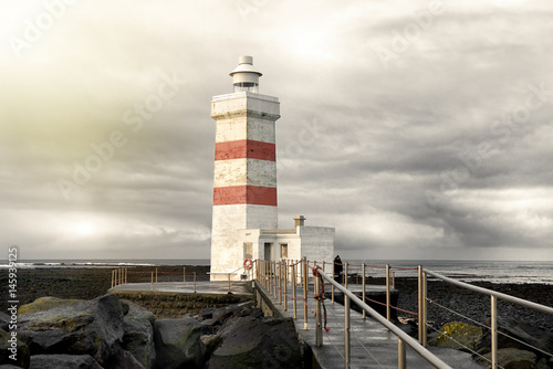 Fotografie, Obraz  The old lighthouse in Gardur, Iceland