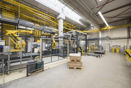 Factory shop floor, industrial robot