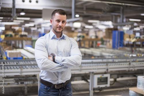 Portrait of confident man in factory