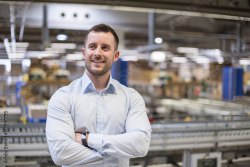 Portrait of confident man in factory