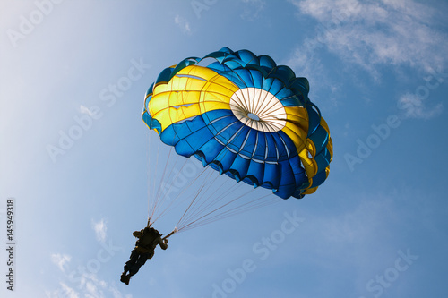 Tuinposter Luchtsport Parachute on background blue sky.