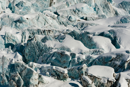 Fotografia, Obraz Glacier flow ice blocks and crevasses snow covered in winter
