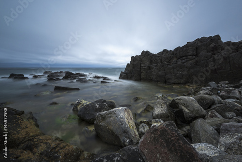 View of seacoast with cliffs. Fotobehang