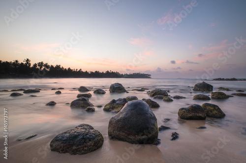 Wall Murals New Zealand Paradise beach of Sri Lanka at sunrise.