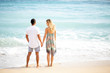 Adult Couple Standing on Sunny Sea Beach
