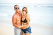 Happy Couple Embracing on Summer Beach