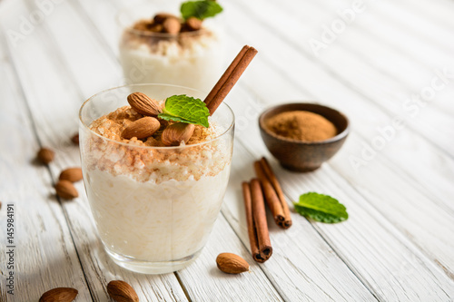 Tuinposter Dessert Creamy rice pudding topped with cinnamon and almond