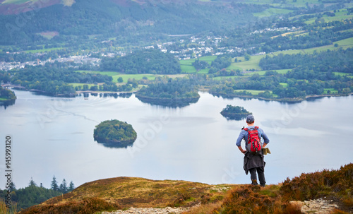 Leinwand Poster A hiker looking out over Derwent Water in the Lake District, England, UK