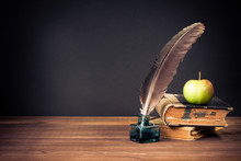 Quill Pen, Old Books, Apple On Table For Vintage Background