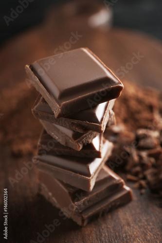 Foto op Aluminium Snoepjes Stack of chocolate pieces on table, closeup