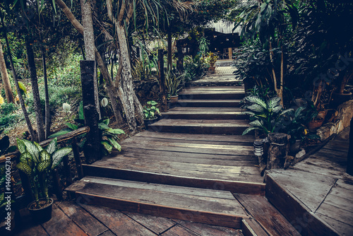 Photo Stands Stairs Old wooden stairs in the garden, selective focus on the steps. vintage tone