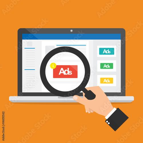 Fototapeta Businessman hand hold a magnifying glass for seeing an advertising on social media website.Vector illustration social ads digital marketing concept. obraz